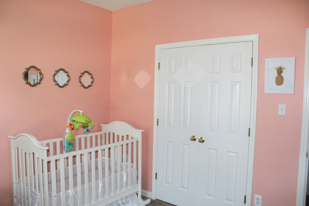 Pink and gold nursery decor